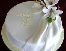 golden-anniv-white-lilies-drape