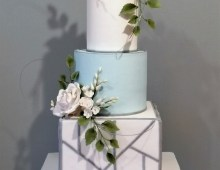 Stacked tiered cake with a square bottom tier