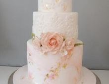Beautiful tiered stack with embossed sides and handmade flowers